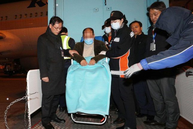 South Korean journalists who were beaten in China during a summit between Chinese President Xi Jinping and South Korean President Moon Jae-in return to their country on Friday. File Photo by Yonhap
