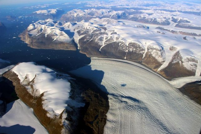 In the summers of 2010 and 2012, scientists measured a new mode of ice loss in Greenland's Rink Glacier. Photo by NASA/OIB