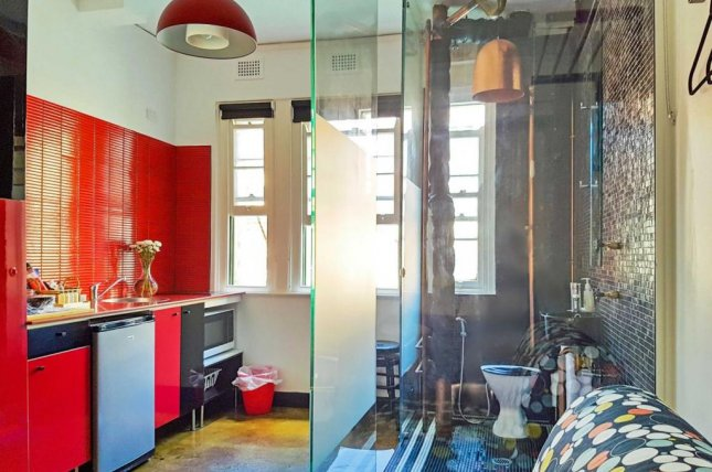 A studio apartment listed in Sydney, Australia, is drawing attention online for the unusual placement of the bathroom -- in the kitchen. Photo courtesy of Exclusive Real Estate/Domain.com.au