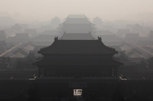 A thick haze engulfs the Forbidden City in Beijing on Monday. Photo by Roman Pilipey/EPA-EFE