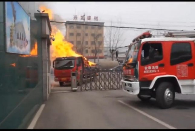 A truck driver whose vehicle caught fire drove directly to the fire station in Hefei, China. Newsflare video screenshot