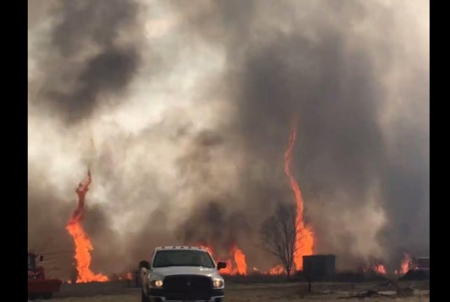A firenado spins flames into the sky during a Missouri wildfire Thursday. Screenshot: Southern Platte Fire Protection District/Facebook