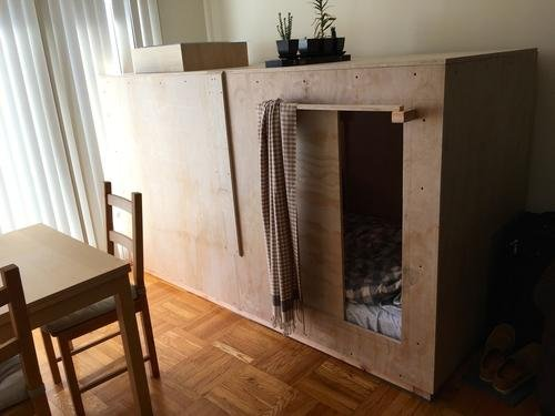 Peter Berkowitz, a 25-year-old illustrator in San Francisco, built a wooden pod in his friends living room to save money on rent. He pays $400 a month in rent and an additional $108 to cover the $1,300 cost of building the pod. Photo by Peter Berkowitz/peteberk.com