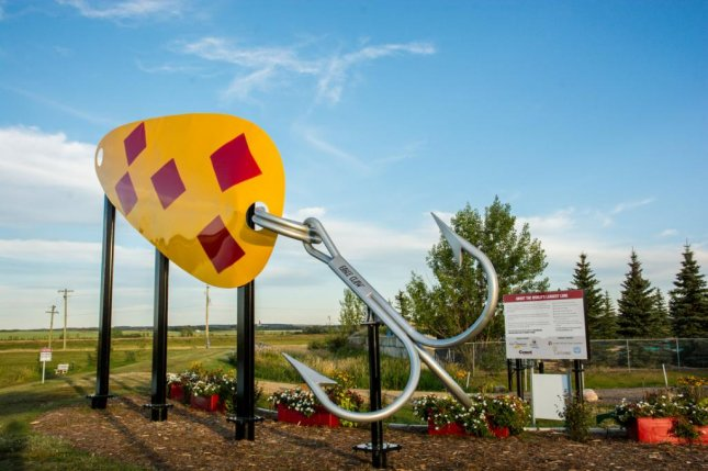 A 40-foot, 5.25-inch sculpture of a fishing lure in Alberta was recognized as the world's largest fishing lure by Guinness World Records. Photo courtesy of Thompson-Pallister Bait Co. Ltd.