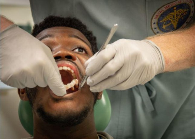 Marine Corps Cpl. Jared Murry undergoes an examination after jaw reconstruction surgery and placement of what the Defense Department called its first use of 3D-printed teeth. Photo courtesy of the Defense Department