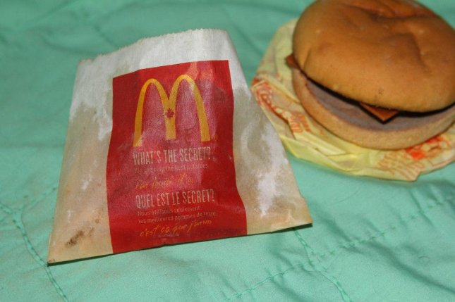 An Ontario man is selling a McDonald's cheeseburger and fries that spent six years on a shelf in his home. Photo by sharonrobyn/eBay.ca