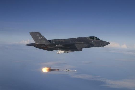 An F-35 Lightning II test-fires an AMRAAM radar-guided missile at Eglin Air Force Base in Florida. Photo by Master Sgt. Michael Jackson/U.S. Air Force