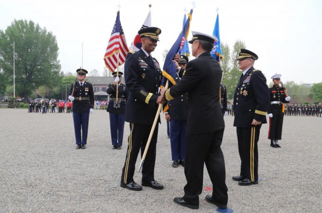Army Gen. Vincent K. Brooks takes the U.S. Forces Korea colors from Navy Adm. Harry B. Harris, the commander of U.S. Pacific Command, on April 30. Photo courtesy of Army Sgt. Russell Youmans/U.S. Department of Defense