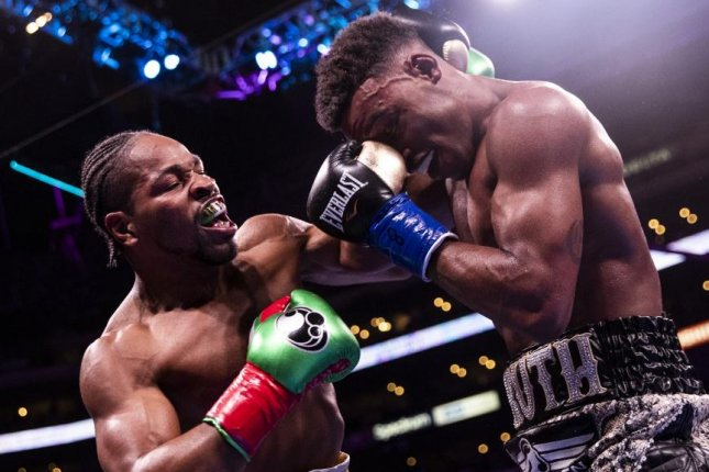 Errol Spence Jr. (R) defeated Shawn Porter (L) in his last bout Sept. 28 in Los Angeles. File photo by Etienne Laurent/EPA-EFE