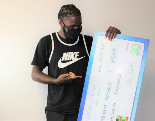 A Virginia man said he decided to buy a scratch-off lottery ticket while waiting for his mother at a grocery store and ended up winning $200,000. Photo courtesy of the Virginia Lottery