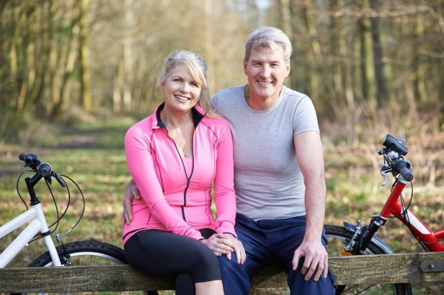 Researchers say participating in exercise at middle age can help protect cognitive function later in life, according to a long-term study of twins in Finland. Photo by SpeedKingz/Shutterstock