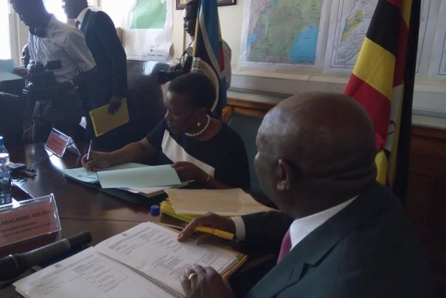 Eng Irene Muloni signs petroleum production licenses for Tullow Oil and Total, which could invest billions of dollars in the country's emerging oil industry. Photo courtesy Uganda Ministry of Energy and Mineral Development/Facebook