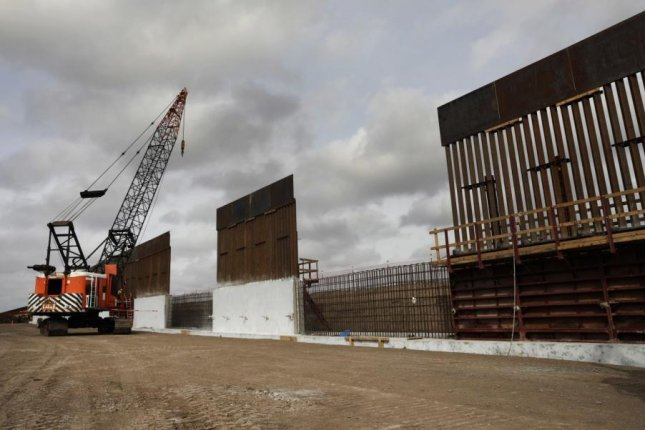 Construction crews work to erect levee wall system in a remote area south of Weslaco, Texas in the U.S. Border Patrol's Rio Grande Valley Sector. Jan. 13, 2019. This week Southwest Valley Constructors was awarded a a $175.4 million contract to construct sections of the border wall in the Rio Grande Valley. Photo by Glenn Fawcett/CBP