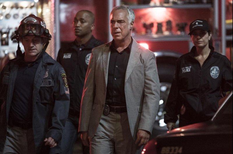 Bosch (Titus Welliver, center) investigates an arson crime scene. Photo courtesy of Amazon Studios