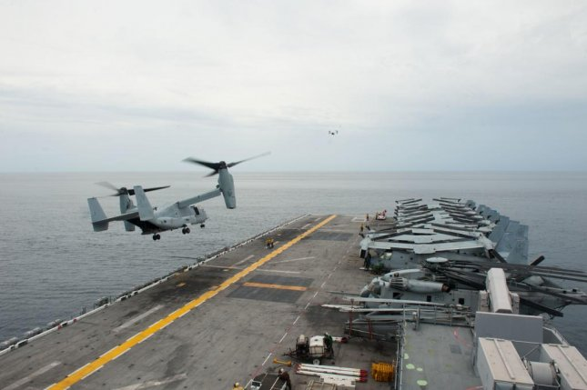 A MV-22 Osprey lands on the USS America amphibious assault ship in the South China Sea. Photo courtesy of the U.S. Navy.