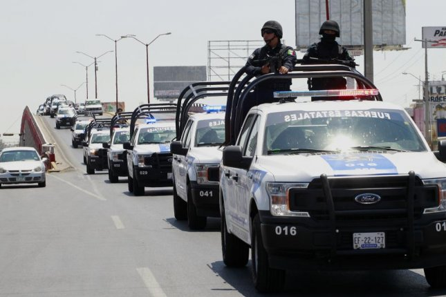 Hundreds of state police arrive in the border city of Juarez, Mexico, on August 4. The city has seen 68 homicides in the first weeks of 2019. File Photo by Hector Dayer/EPA-EFE