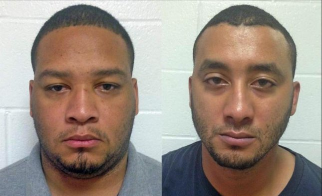 Marksville, Louisiana Police Officer Derrick W. Stafford (at left) and Alexandria City Marshal Norris J. Greenhouse Jr. were charged with second degree murder and attempted second degree murder in a shooting that left a six-year-old boy dead and his father in critical condition. Photo from Louisiana State Police