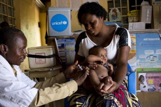 A child is inoculated against measles in a clinic in Lumumbashi, Democtraic Republic of Congo.  Photo courtesy UNICEF