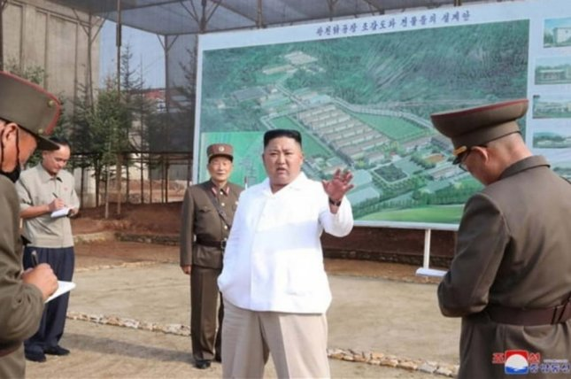 Kim Jong Un (C) provided instructions at North Korea's Kwangchon Chicken Farm in North Hwanghae Province, state media said Thursday. Photo by KCNA
