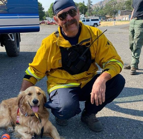 Probie the fire dog visits with firefighting crews at the Sunset Valley Fire near The Dalles, Ore. Photo by Probie the fire dog/Instagram