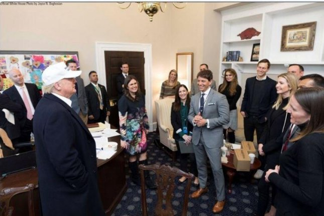President Donald Trump appears in the Oval Office with staff members on Saturday during the government shutdown. Photo courtesy of Sarah Sanders/White House/Twitter