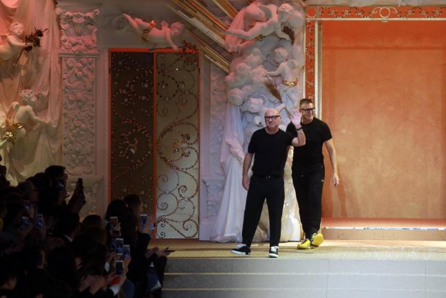Italian fashion designers Domenico Dolce (L) and Stefano Gabbana (R) are under fire for a series of ads deemed racist in China. File Photo by Matteo Bazzi/EPA-EFE