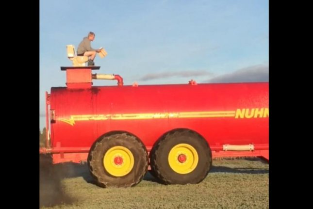 Watch: Man does his business into a farmer's manure tank