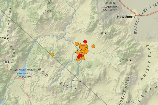 Nearly two dozen earthquakes measuring magnitudes of at least 2.5 have occurred in southwest Nevada in the past 24 hours. In this image, the larger earthquakes are seen as larger circles, while the most recent earthquakes are seen in the color red. Three earthquakes -- two measuring magnitudes 5.5 and one in magnitude-5.7 -- struck the region early Wednesday. Photo courtesy of U.S. Geological Survey