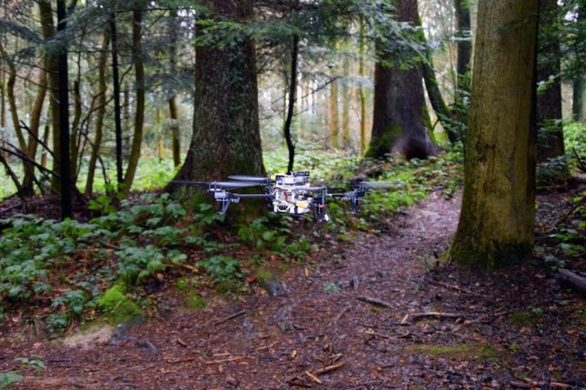 New software is helping a drone navigate forest trails. Photo by UZH/USI/SUPSI