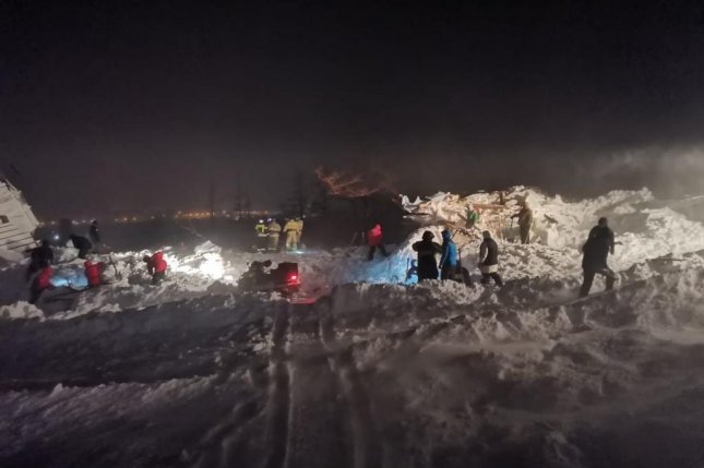 Russian rescuers conduct a search and rescue operation at the site of an avalanche at the Gora Otdelnaya ski resort in Norilsk, Krasnoyarsk region, Russia, Friday. EPA-EFE/EMERCOM OF RUSSIA PRESS SERVICE
