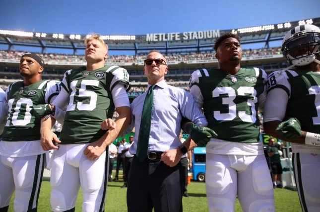 New York Jets owner Christopher Johnson (center) locked arms with quarterback Josh McCown (15) and rookie safety Jamal Adams (33). General manager Mike Maccagnan also stood amongst the Jets. Photo courtesy of New York Jets/Twitter