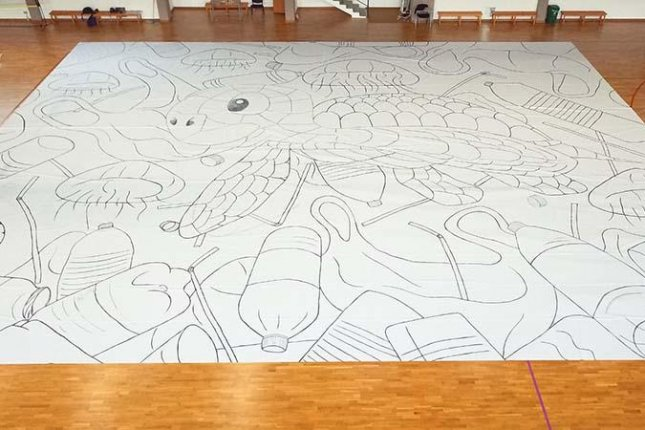 A Cyprus teen broke a Guinness World Record and raised money for conservation charities when he created a drawing measuring a total 3,486 square feet, 61 square inches. Photo courtesy of Guinness World Records