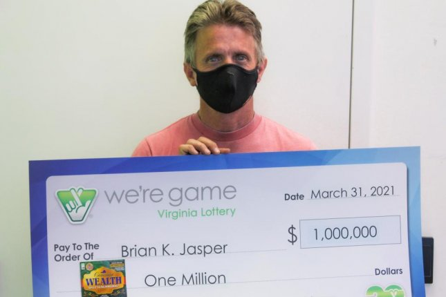 Brian Jasper, of Fuquay Varina, N.C., said he stopped at a store in Fredericksburg, Va., to get dish soap for his job and ended up buying a scratch-off lottery ticket that earned him a $1 million jackpot. Photo courtesy of the Virginia Lottery