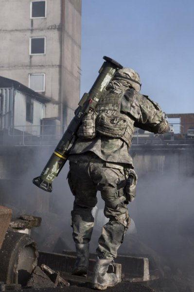 A soldier carrying Saab's shoulder-launched AT4 disposable weapon system. Photo courtesy of Saab