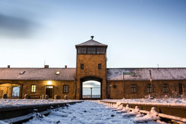 Main gate to Nazi concentration camp Auschwitz in Poland. Friday, German prosecutors announced they have dropped the Nazi war crimes investigation of 96-year-old retired carpenter Michale Karkoc, who now lives in Minnesota. Photo by Sopotnicki/Shutterstock