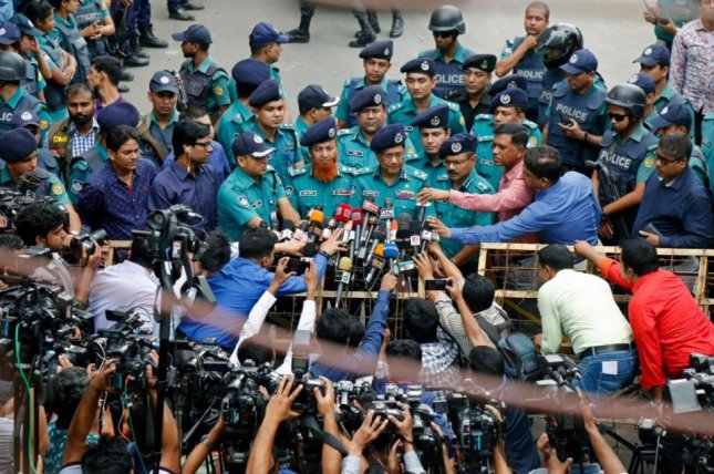 Bangladeshi police speak to reporters in Dhaka Wednesday as verdicts in a 2004 grenade attack were announced. The court sentenced 19 people to death for the attack. Photo by Moniril Alai/EPA-EFE