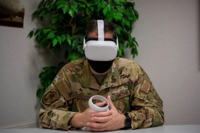 Using a virtual reality headset, an Airman at Travis Air Force Base, Calif., participates in a suicide prevention scenario. Photo by Nicholas Pilch/U.S. Air Force