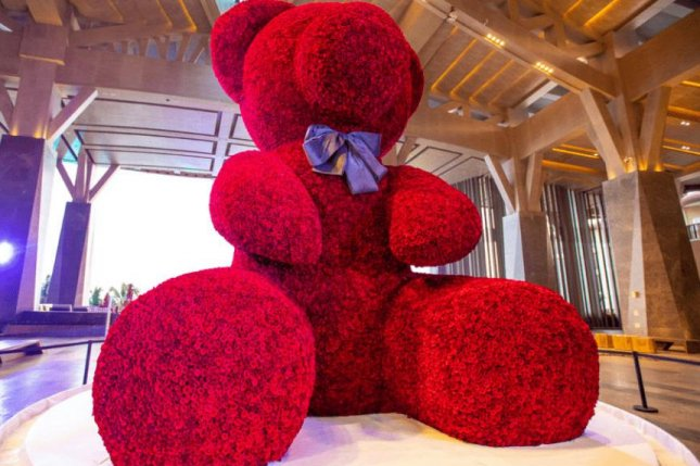 A 20-foot-2-inch tall bear made from 18,000 roses attached to a metal frame broke a Guinness World Record when it was constructed for a marriage vow renewal ceremony for 108 couples in China. Photo courtesy of Guinness World Records