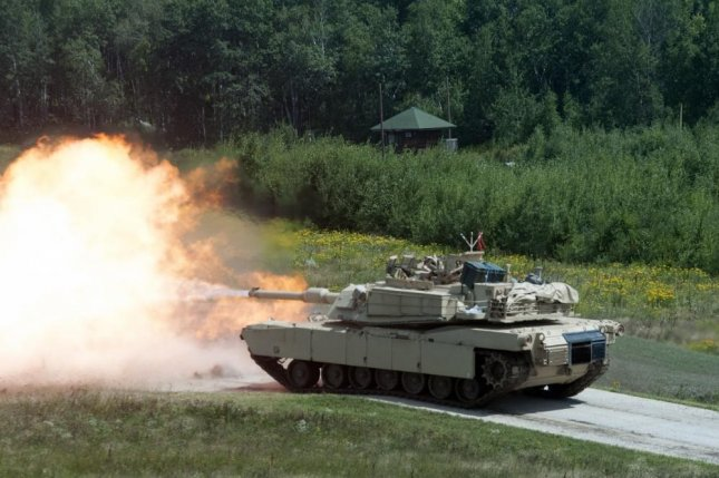 An Abrams tank fires during a gunnery proficiency table August 4, 2017, during annual training at Camp Ripley in Minnesota. Photo by 1st Lt. Aaron Smith, 174 Air Defense Artillery Brigade/U.S. Army