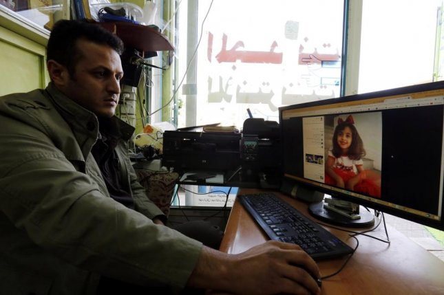 A Yemeni man at a cafe in Sana'a, Yemen, looks at the picture of an 8-year-old Yemeni girl, Anwar al-Awlaki, who reportedly died during a U.S. raid of an al-Qaeda compound in central Yemen. Elite U.S. forces launched an intelligence gathering raid around dawn on January 29, 2017, resulting in the deaths of at least 14 militants and dozens of civilians. The U.S. military is investigating what led to a ferocious firefight and how many people died as a result, including the eight-year-old, who was the daughter of a US-born Yemeni preacher who was killed in an American drone strike in 2011. Photo by Yahya Arhab/EPA