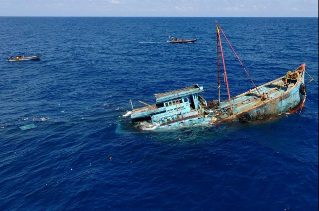 A handout picture made available by the Indonesian Ministry of Maritime Affairs and Fisheries on Aug. 18, 2016 shows illegal fishing vessels sunk by Indonesian authorities in the waters near the Natuna Islands, Indonesia. Researchers have recently developed algorithms they hope authorities will use to synthesize big data and pinpoint illegal fishing vessels. File Photo by EPA/Ministry of Maritime Affairs and Fisheries/Handout
