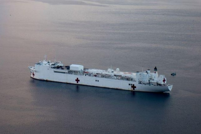 The USNS Comfort, pictured anchored off the coast of Honduras in December, has been deployed to the Caribbean, Central America and South America to offer humanitarian medical assistance in regions affected by the crises in Venezuela. Photo by Mass Communications Specialist 1st Class Scott Bigley/U.S. Navy