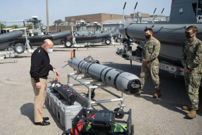 Torpedo-shaped MK 18 unmanned underwater vehicles were involved in mine countermeasure certification exercises at Naval Support Activity Panama City, Fla., this month. Photo courtesy of EODMU2/Facebook