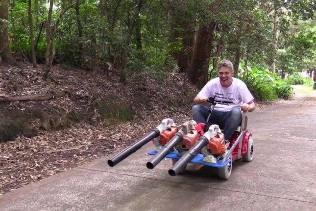 watch leaf blowers mounted to go cart to make chores faster upi com