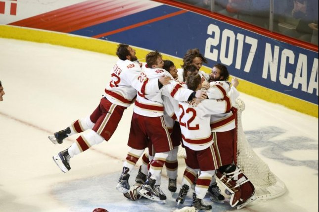 Denver Pioneers players celebrate winning the 2017 NCAA Men's Ice Hockey Championship in Chicago on April 8, 2017. Photo courtesy NCAA via Twitter