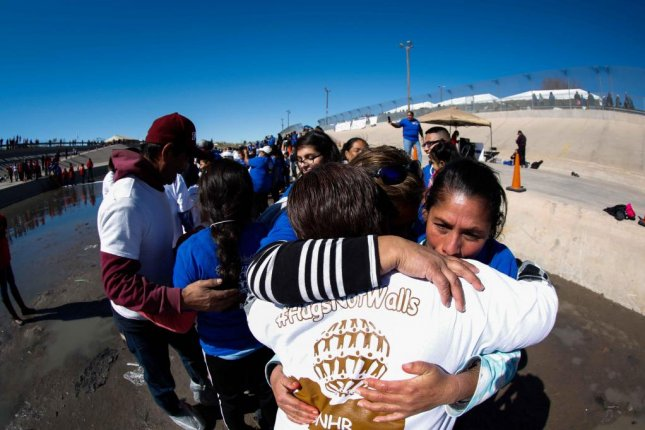 Immigrant families separated by the international border between El Paso, Texas and Ciudad Juárez, Mexico meet for Hugs Not Walls on January 28, 2017. File Photo by Alejandro Bringas/EPA
