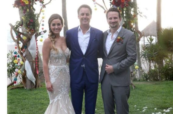 Carly Waddell (L) with Bachelor host Chris Harrison (C) and husband Evan Bass on her wedding day. The reality star gushed about her pregnancy in an interview this week after marrying Bass in June. Photo by Carly Waddell/Instagram