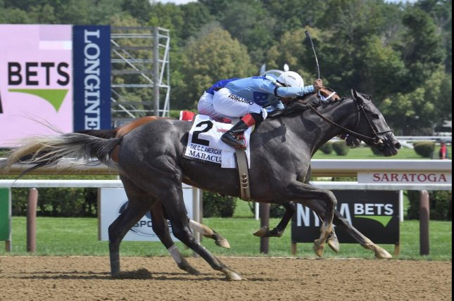 Maracuja edges previously undefeated Malathaat in Saturday's Grade I coaching Club American Oaks at Saratoga. Photo by Susie Raisher, courtesy of New York Racing Association