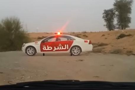 There's something strange about this police car on the side of a road in the United Arab Emirates. Screenshot: ViralHog