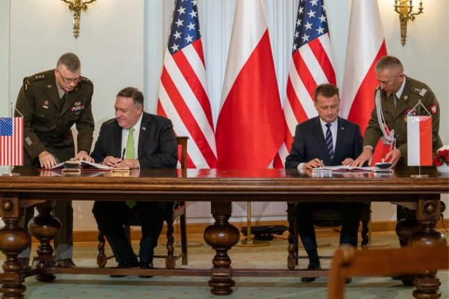 Secretary of State Mike Pompeo (2nd-L) and Polish Defense Minister Mariusz Błaszczak (2nd-R) signed an agreement Saturday to increase U.S. military presence in Poland. Photo via Secretary Pompeo/Twitter